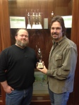Tim holding Marcom Award
